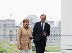 Řecký premiér Samaros s německou kancléřkou Merkelovou. Autorem snímku je Matanya.